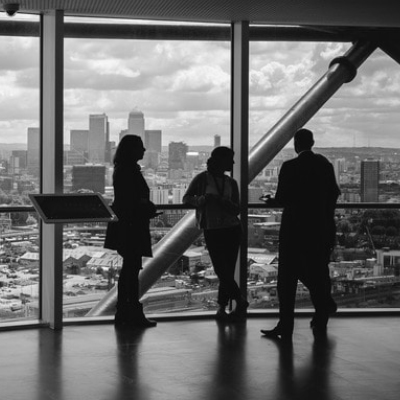 Image showing people standing in a room with a view over the city